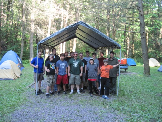 Boy Scout Troop 759 poses in front of the rain fly they obtained through a donation from the Sandy Spring Lions Club