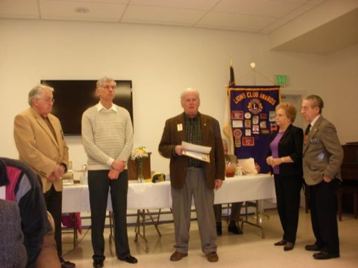 New Lions John McCloskey and Carole Derrick are inducted by Past District Governor Bill Thomas